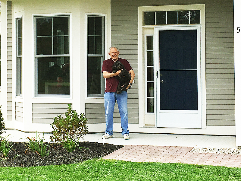 Cumberland Crossing's first residents - Ron and dog Zoe.