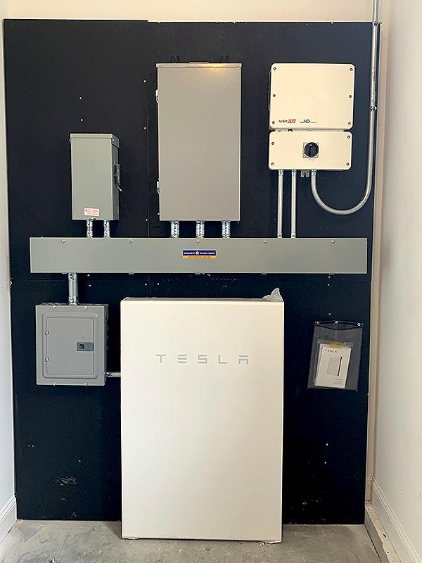 Tesla Powerwall installed in Cumberland Crossing Model Cottage.